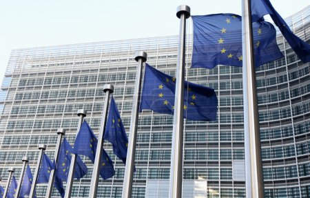 Photo for European flags in front of the Berlaymont building, headquarters of the European commission - Royalty Free Image