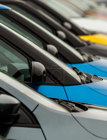 Car wingmirrors on display on dealers forecourt