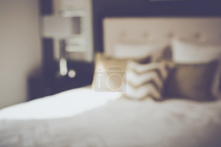 Photo for Blurred Bedroom with Bed and Nightstand with Reto Instagram Style Filter - Royalty Free Image
