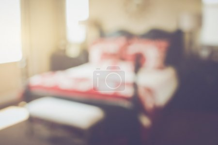 Blurred Bedroom with Bed as background