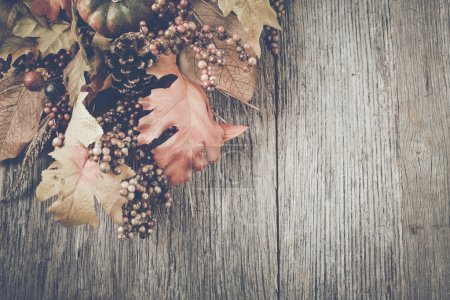 Autumn Leaves on Rustic Wood Background