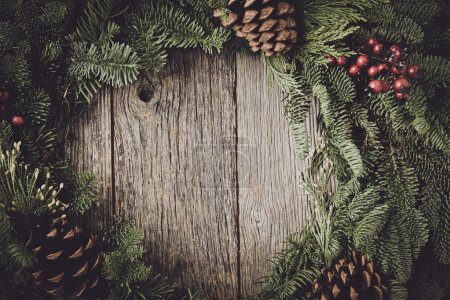 Photo for Christmas Wreath and pine cones with Rustic Wood Background - Royalty Free Image
