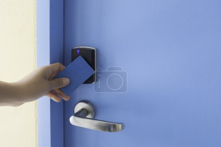 left hand hold key card touch on electronic pad lock access cont