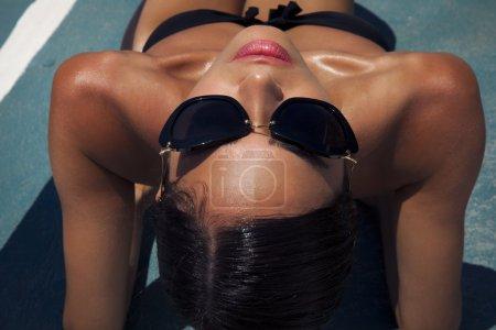 Beautiful woman in bikini and black sunglasses