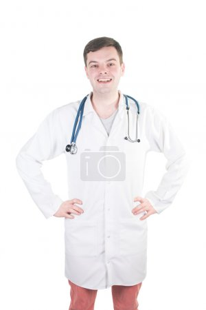 Portrait of confident young medical doctor on isolated background