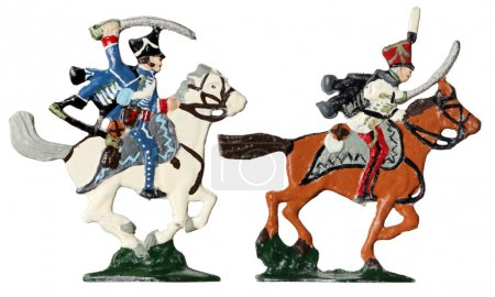 Photo for Set of two ancient tin toy soldiers. French armed by sabers and hussars horsemen in traditional clothes against white background. - Royalty Free Image