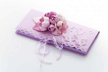 Close up of an invitation envelope decorated with flowers