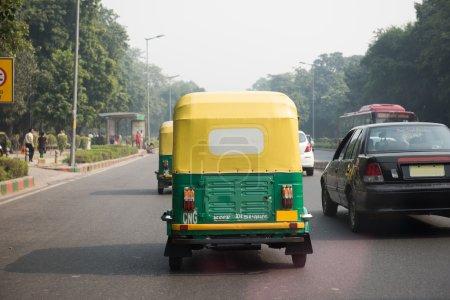 Auto rickshaw on a Road in Delhi