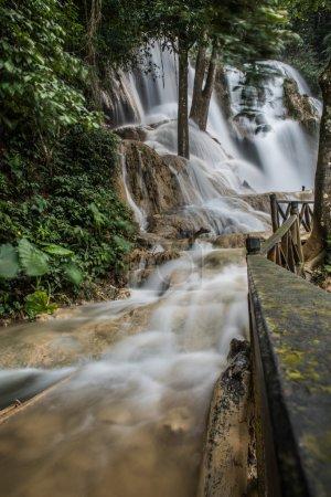 Walking By Kouang Xi Falls