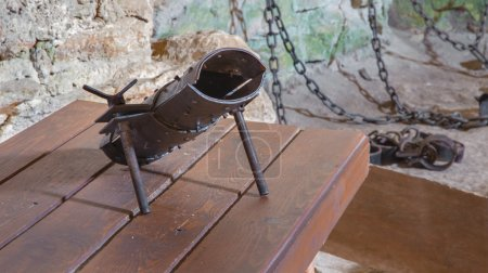 SPISSKY CASTLE, SLOVAKIA - JULY 19, 2014: The highboot for torture from oubliette the castle.