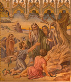 TRNAVA, SLOVAKIA - OCTOBER 14, 2014: The neo-gothic fresco of fhe scene as Moses made a bronze snake by Leopold Bruckner (1905 - 1906) in Saint Nicholas church.
