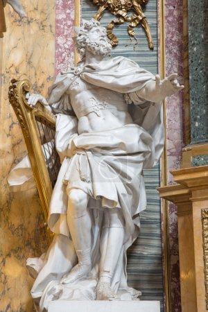 ROME, ITALY - MARCH 25, 2015: The statue of The King David by Andre Jean Lebrun (1769) from side chapel of Immaculate Comception in baroque church Basilica dei Santi Ambrogio e Carlo al Corso.