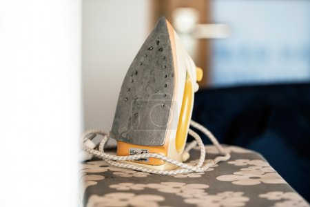 Photo for Old Iron on ironing board. - Royalty Free Image