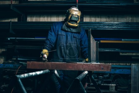 Welder with mask in workplace