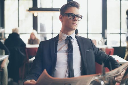 Young businessman with retro glasses