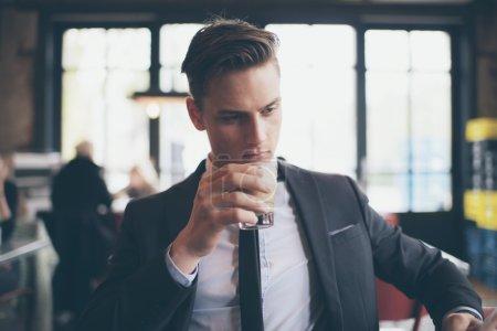 Single man drinking coffee in cafe