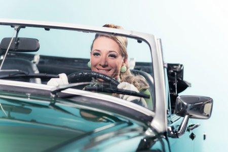 woman in sports car.