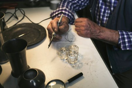 Photo for Hand of senior man with soldering iron - Royalty Free Image
