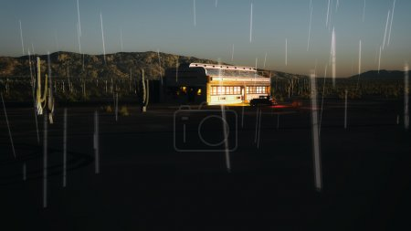 Desert landscape with diner and vintage car in the rain at sunse