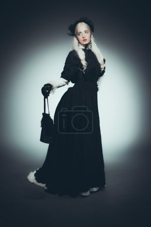 Woman with Hand Bag in Black Gown