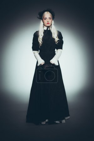 Woman with White Hair in Black Gown
