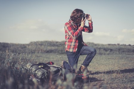 Nature photographer taking a photograph