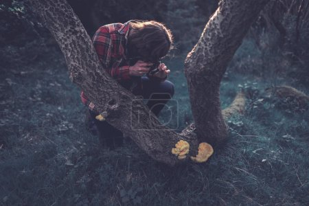 Photographer taking a photo of a fungus