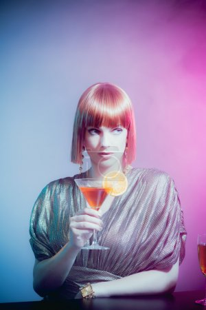 Glamorous Woman Sipping Cocktail