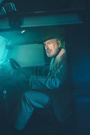Senior Man Seating on Drivers Seat