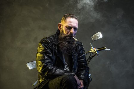Adult Man Smoking Cigarette on his Motorcycle