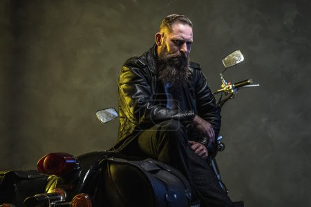Bearded Biker Man Sitting on a Motorcycle