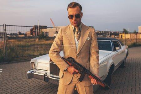 Retro gangster with machine gun
