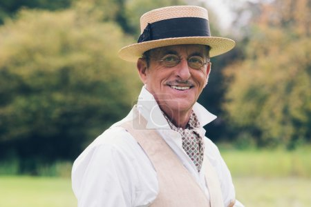 Photo for Smiling senior man in suit and hat enjoying his estate. - Royalty Free Image