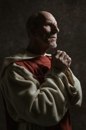Side view portrait of wishing monastic.