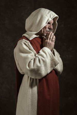 Side view portrait of praying monastic