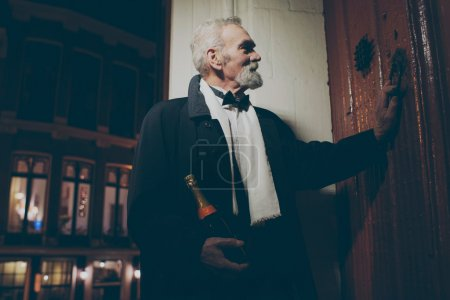 Man in tuxedo with bottle of champagne