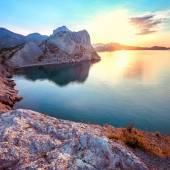 Dawn at Black sea. Morning seascape with mountains. Ukraine. Crimea