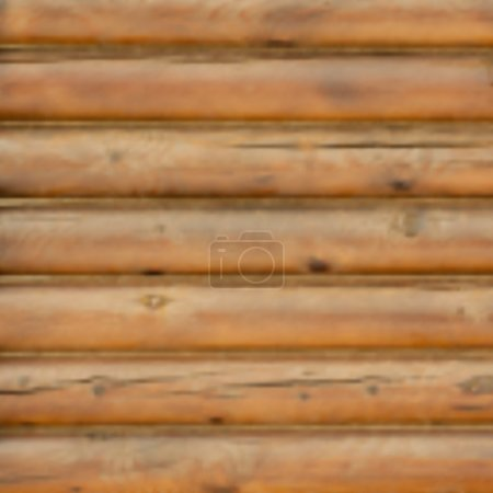 Blurred background wall from logs.