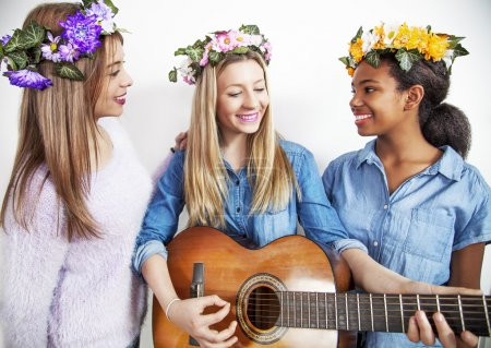 Cute teenage mixed race girls with acoustic guitar
