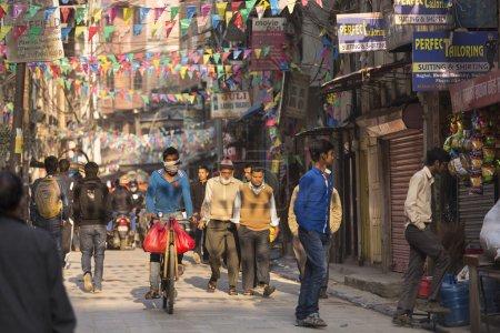 THAMEL, KATHMANDU, NEPAL - NOVEMBER 20, 2014: Bicycle driving by