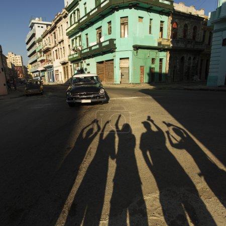 Silhouette of happy people on street of Havana, Cuba