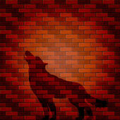 Shadow of wolf on a brick wall