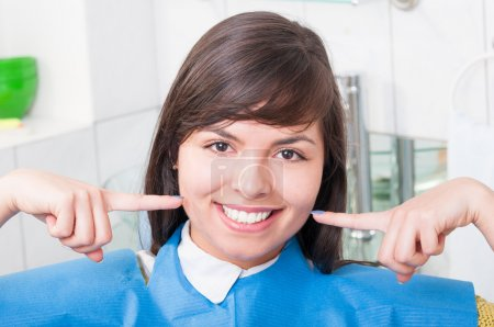 Close-up of happy patient in dentistry office smiling