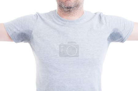 Man with arms raised and sweat stains