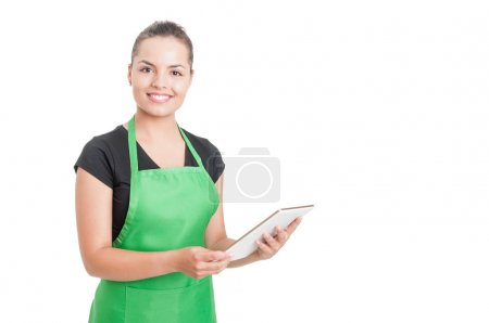 Photo for Successful hypermarket employee with green apron holding modern tablet isolated on white background with copyspace - Royalty Free Image