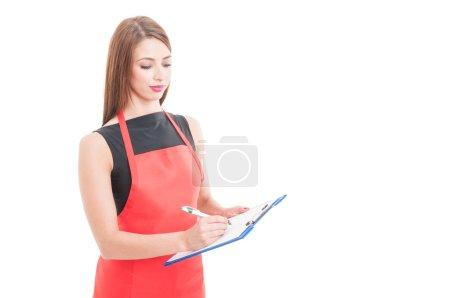 Professional employee writing something on clipboared