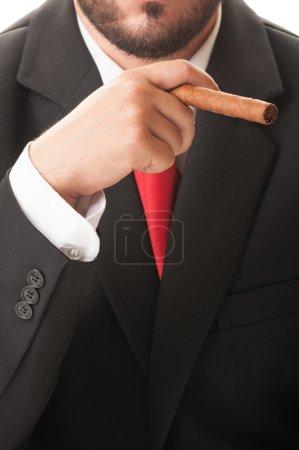 Business man smoking a cuban cigar