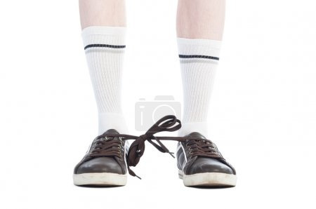 Photo for Long socks and shoe laces tied together prank on white background - Royalty Free Image