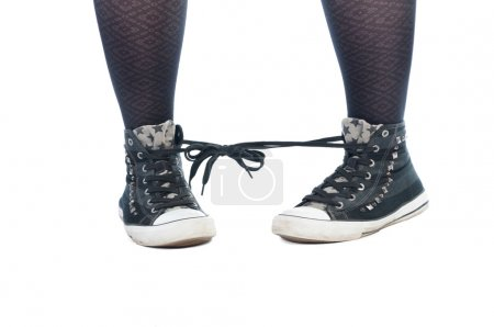 Photo for Shoe laces tied together prank isolated on white background - Royalty Free Image
