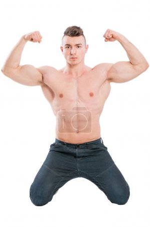 Male model on his knees flexing strong arms
